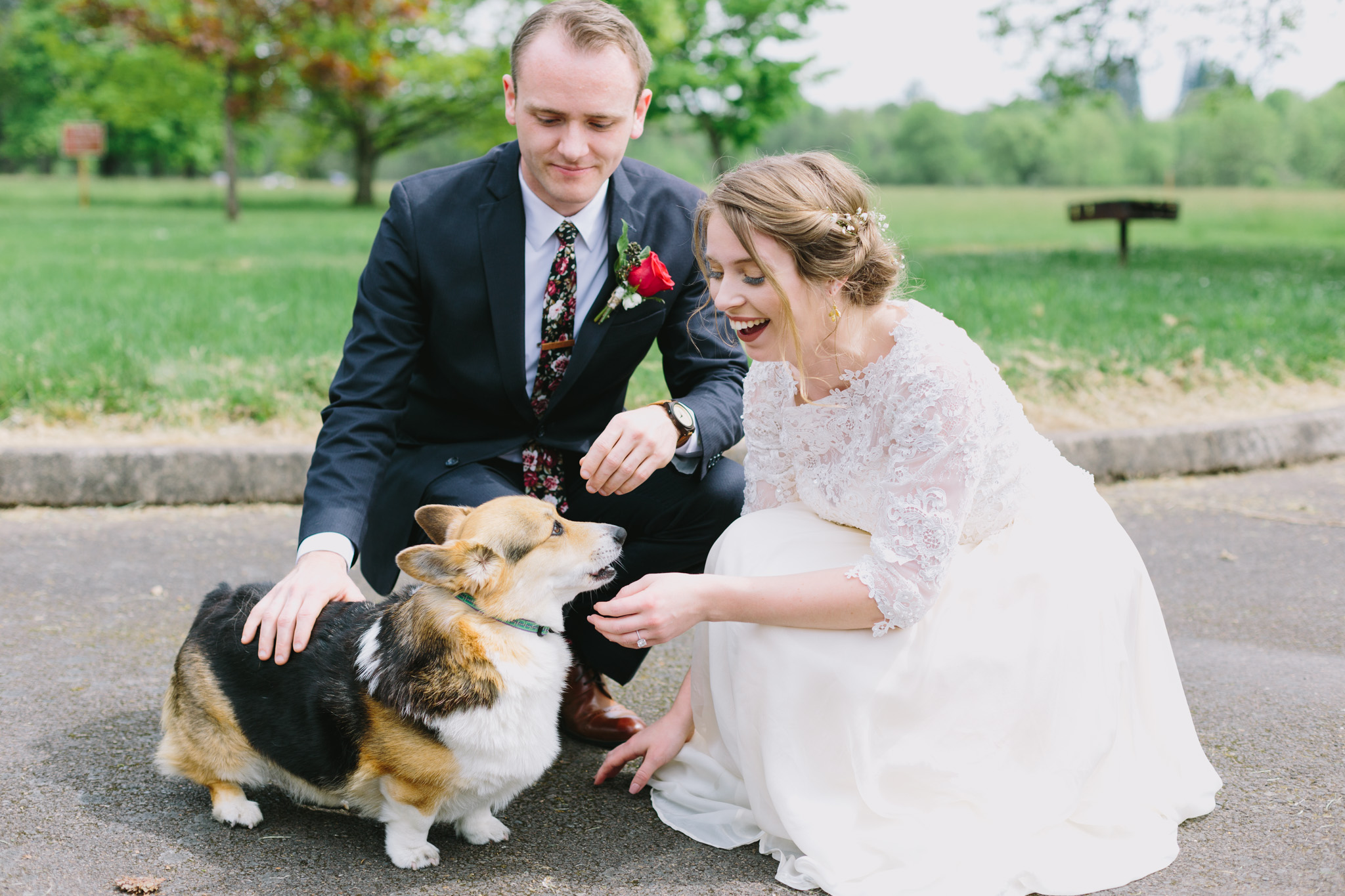 Bride and Groom petting a corgi