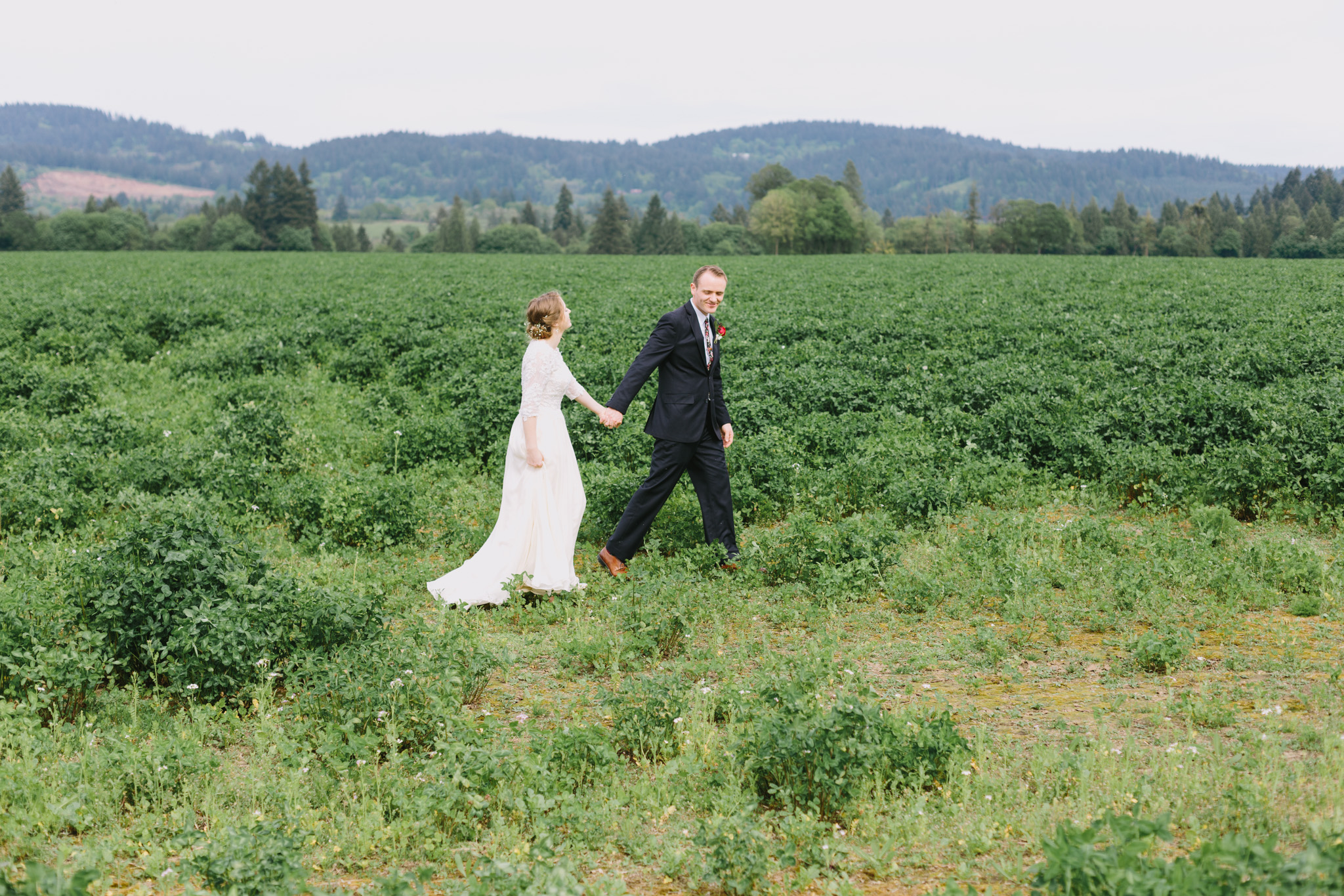 Bride and Groom in open green field